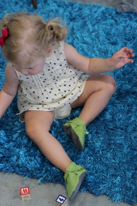 toddler wearing mally mocs leather baby moccasins